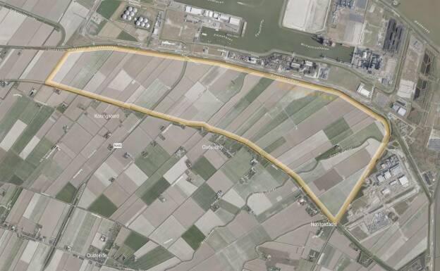 Een luchtfoto met de begrenzing van het plangebied