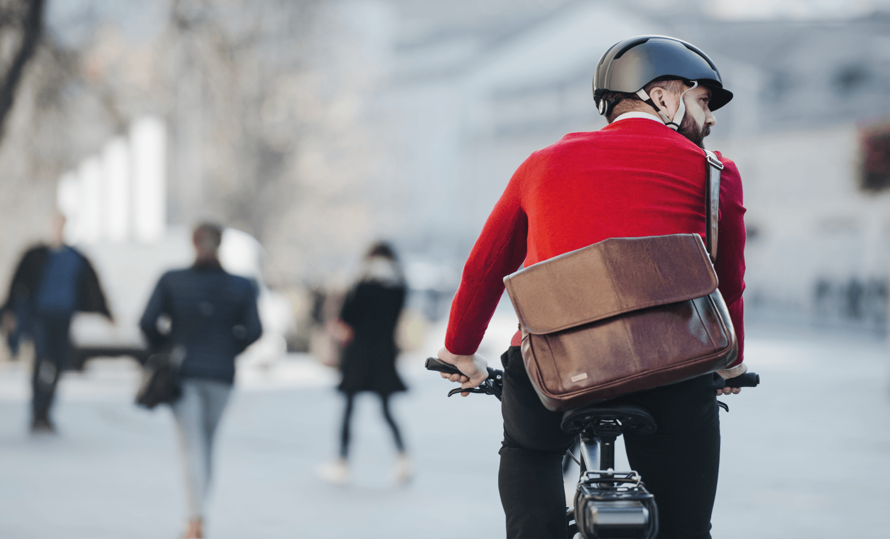 man-on-bike-decarbonising-transport.png