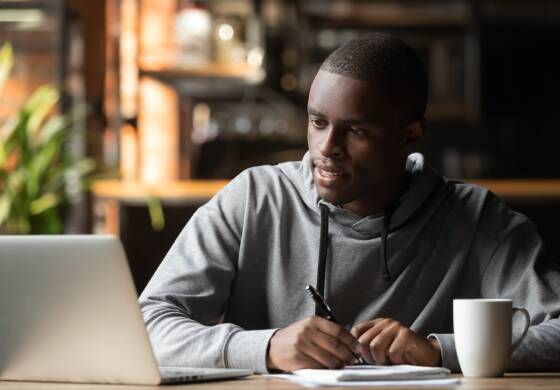 6.5._stock-photo-focused-young-black-man-working-studying-with-wireless-laptop-make-notes-in-cafe-focused-african-1492614011.jpg